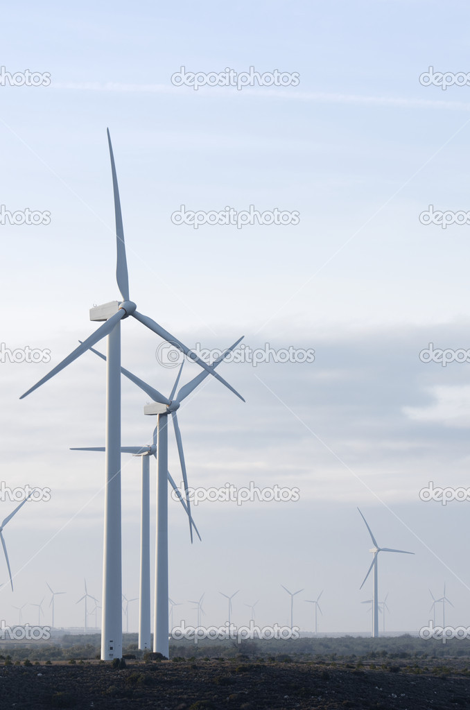 Windmills for electricity production with cloudy sky — Stock Photo #5394103