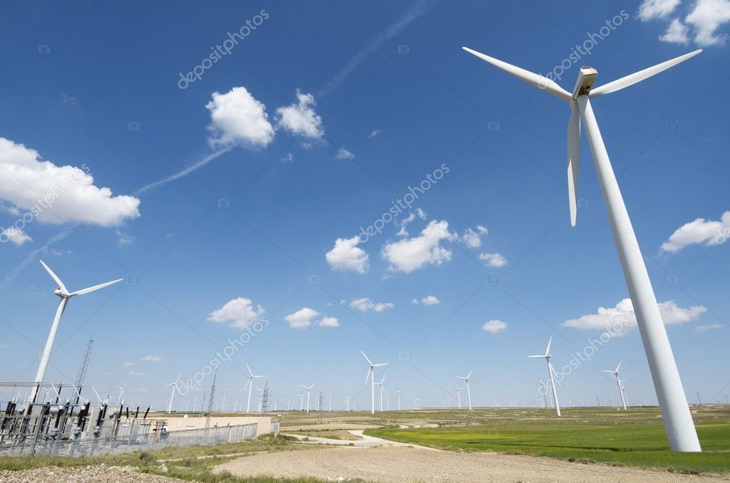 Windmills for  electric power production and  electrical substation — Stock Photo #5703156