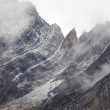Rugged mountains in the winter fog — Stock Photo #5781483
