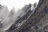 Rugged mountains in the winter fog — Stock Photo