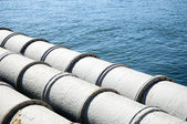 Pipes leading out to sea — Stock Photo