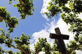 Cross above the trees — Stock Photo