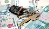 Key from car and thousand of rubles — Stock Photo