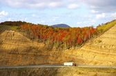 Road in autumn mountain — Stock Photo