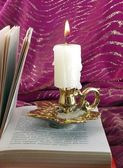 Candle and book — Stock Photo