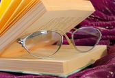 Book and spectacles — Stock Photo