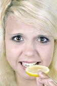 Girl with a lemon — Stock Photo