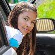 Stock Photo: Beautiful girl in car on street