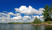 Summer Clouds on Knife Lake — Stock Photo