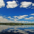 Blue skies and white clouds in the Quetico — Stock Photo