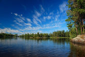 A wilderness lake and summer skies — Stock Photo