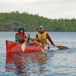 Stock Photo: Family canoeing in wilderness