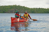 Family canoeing in the wilderness — Stock Photo