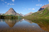 Reflections in an alpine lake — Stock Photo