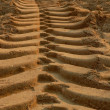 Stock Photo: Trace of a bulldozer in the sand-1