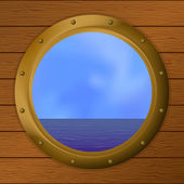 Sea in a bronze ship window — Stock Photo