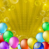 Balloons and bubbles on gold — Stock Photo