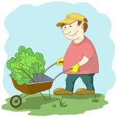 Man gardener works in a garden — Stock Photo