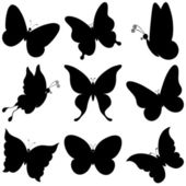 Butterflies, black silhouettes — Stock Photo