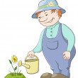 Gardener waters a flower — Stock Photo