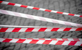 Red and white striped tapes — Stock Photo