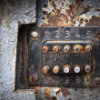 Stock Photo: Old rusted coded lock