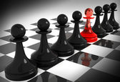 One red pawn among seven black — Stock Photo