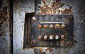 Old rusted coded lock — Stock Photo