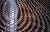 Background with chamfered corner of a brick wall — Stock Photo