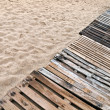 Wooden boards path on the beach - Stock Photo
