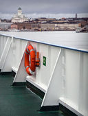 Ferry railings with lifebuoy — Stock Photo