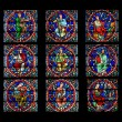 Stained glass window. Notre Dame Cathedral in Paris - Stock Photo