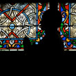 Statue in front of stained glass window - Stock Photo