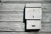 Old mail box on the wooden wall — Stock Photo