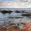 Red stone coast of  Mediterranean Sea — Stok fotoğraf