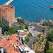 Red brick tower in port of Alanya — Stock Photo