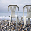 Two chairs on the seacoast — Stock Photo