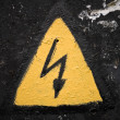 Yellow high voltage sign — Stock Photo