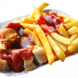 Currywurst and french fries — Stock Photo