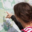 Stock Photo: Hiker looking map