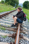 Railway and woman hiker — Stock Photo