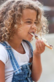 Little girl and slice of bread — Stock Photo