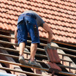 Stock Photo: Worker on roof