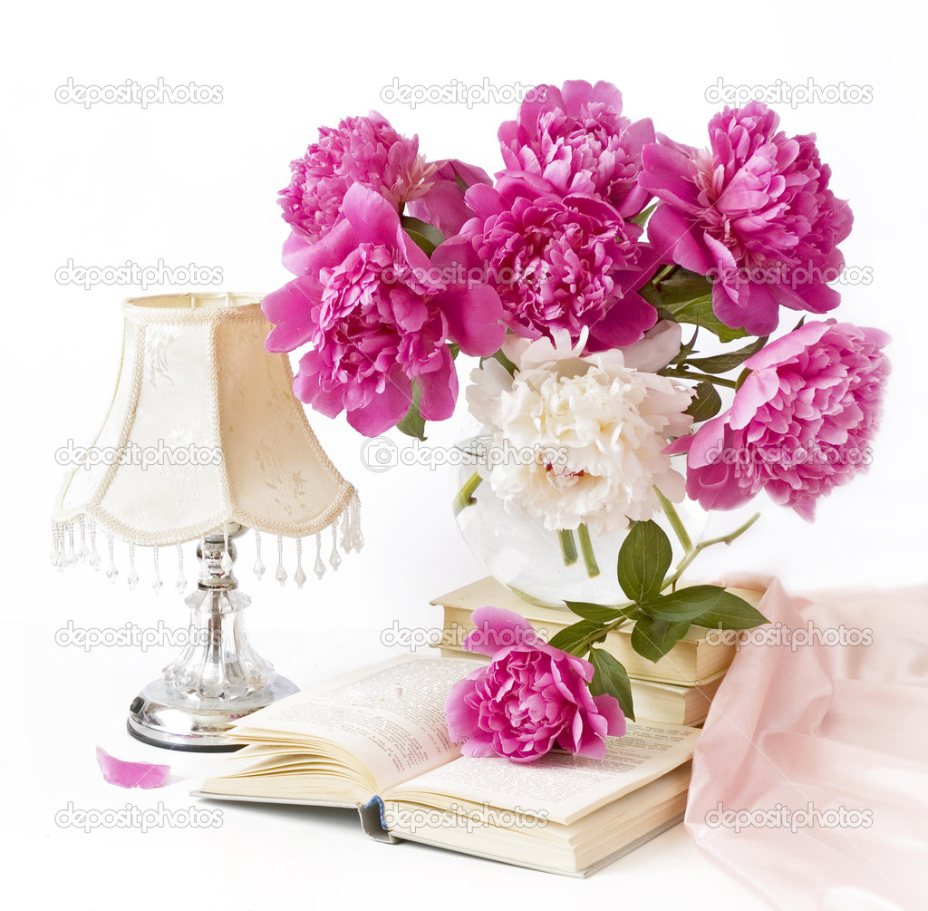 Still-life with pink peonies in vase, lamp and book — Stock Photo #5379240