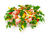 Ham roll with fresh vegetables and parsley. — Stock Photo
