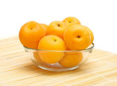 Ripe apricots in a glass bowl — Stock Photo