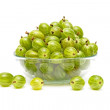 Gooseberries in a glass bowl on a white background — Stock Photo