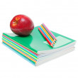 Notebooks, pencils and apple — Stock Photo