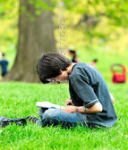 The boy draws in park — Stock Photo