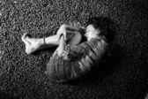 Girl sleeping on a hazelnuts — Stock Photo